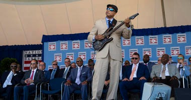 Former New York Yankees center fielder Bernie William performs Take Me Out to the Ball Game during to the 2019 National Baseball Hall of Fame induction ceremony at the Clark Sports Center.