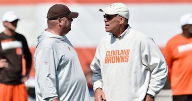 Cleveland Browns head coach Freddie Kitchens (left) talks with general manager John Dorsey during training camp at the Cleveland Browns Training Complex.