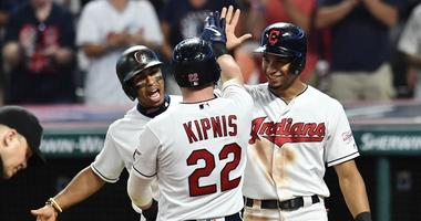 Jul 31, 2019; Cleveland, OH, USA; Cleveland Indians shortstop Francisco Lindor (12) and center fielder Oscar Mercado (35) celebrate with second baseman Jason Kipnis (22) after Kipnis hit a three-run home run during the sixth inning against the Houston Ast