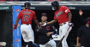 Sep 20, 2019; Cleveland, OH, USA; Cleveland Indians shortstop Francisco Lindor (12) celebrates with right fielder Yasiel Puig (66) and manager Terry Francona (77) during the first inning against the Philadelphia Phillies at Progressive Field. Mandatory Cr