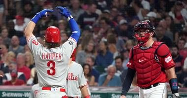 Sep 21, 2019; Cleveland, OH, USA; Philadelphia Phillies right fielder Bryce Harper (3) celebrates after hitting a three-run home run in the fifth inning as Cleveland Indians catcher Kevin Plawecki (right) looks on at Progressive Field. Mandatory Credit: K