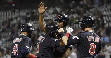 Sep 24, 2019; Chicago, IL, USA; Cleveland Indians third baseman Jose Ramirez (11) is congratulated by teammates after his grand slam in the first inning against the Chicago White Sox at Guaranteed Rate Field. Mandatory Credit: Quinn Harris-USA TODAY Sport