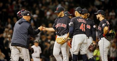 Cleveland Indians starting pitcher Aaron Civale (67) gives the ball to manager Terry Francona (77)