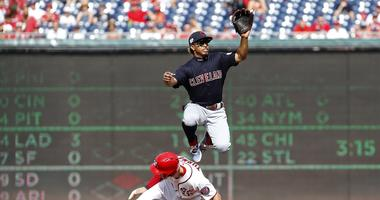 Sep 29, 2019; Washington, DC, USA; Washington Nationals shortstop Trea Turner (7) steals second base as Cleveland Indians shortstop Francisco Lindor (12) leaps to catch the throw from home plate in the first inning at Nationals Park. Mandatory Credit: Geo