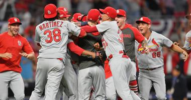 Oct 9, 2019; Atlanta, GA, USA; Members of the St. Louis Cardinals celebrate after defeating the Atlanta Braves in game five of the 2019 NLDS playoff baseball series at SunTrust Park. Mandatory Credit: Dale Zanine-USA TODAY Sports