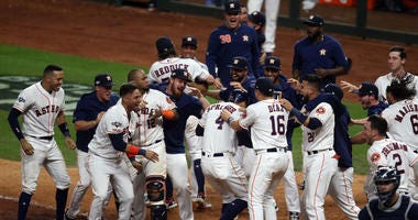 The Houston Astros celebrate after defeating the New York Yankees in game six of the 2019 ALCS playoff baseball series at Minute Maid Park.