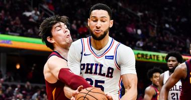 Nov 17, 2019; Cleveland, OH, USA; Cleveland Cavaliers forward Cedi Osman (left) battles Philadelphia 76ers guard Ben Simmons (25) for the ball during the first half at Rocket Mortgage FieldHouse. Mandatory Credit: Ken Blaze-USA TODAY Sports