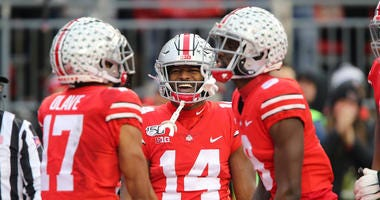 Ohio State Buckeyes wide receiver K.J. Hill (14) celebrates with wide receiver Chris Olave (17)