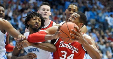 North Carolina Tar Heels guard Leaky Black (1) defends as Ohio State Buckeyes forward Kaleb Wesson (34) looks to shoot in the first half at Dean E. Smith Center.