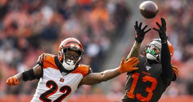 Cleveland Browns wide receiver Odell Beckham (13) catches the ball as he runs out of bounds as Cincinnati Bengals cornerback William Jackson (22) covers him during the second quarter at FirstEnergy Stadium. Beckham was out of bounds when he gained contro