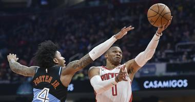 Dec 11, 2019; Cleveland, OH, USA; Houston Rockets guard Russell Westbrook (0) drives against Cleveland Cavaliers guard Kevin Porter Jr. (4) in the second quarter at Rocket Mortgage FieldHouse. Mandatory Credit: David Richard-USA TODAY Sports