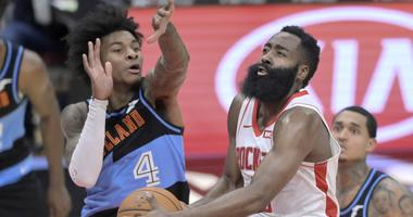 Dec 11, 2019; Cleveland, OH, USA; Houston Rockets guard James Harden (13) drives against Cleveland Cavaliers guard Kevin Porter Jr. (4) in the third quarter at Rocket Mortgage FieldHouse. Mandatory Credit: David Richard-USA TODAY Sports