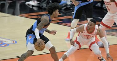 Dec 11, 2019; Cleveland, OH, USA; Houston Rockets guard Russell Westbrook (0) loses his balance while guarding Cleveland Cavaliers guard Kevin Porter Jr. (4) in the third quarter at Rocket Mortgage FieldHouse. Mandatory Credit: David Richard-USA TODAY Spo