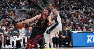 Dec 12, 2019; San Antonio, TX, USA; Cleveland Cavaliers forward Kevin Love (0) dribbles the ball around San Antonio Spurs guard DeMar DeRozan (10) in the first half at the AT&T Center. Mandatory Credit: Daniel Dunn-USA TODAY Sports