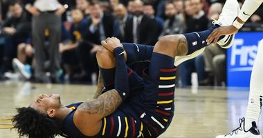 Jan 5, 2020; Cleveland, Ohio, USA; Cleveland Cavaliers guard Kevin Porter Jr. (4) holds his knee after suffering an injury during the second half against the Minnesota Timberwolves at Rocket Mortgage FieldHouse. Mandatory Credit: Ken Blaze-USA TODAY Sport