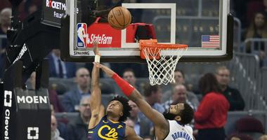Jan 7, 2020; Cleveland, Ohio, USA; Cleveland Cavaliers guard Collin Sexton (2) makes a reverse layup against Detroit Pistons center Andre Drummond (0) in the first quarter at Rocket Mortgage FieldHouse. Mandatory Credit: David Richard-USA TODAY Sports