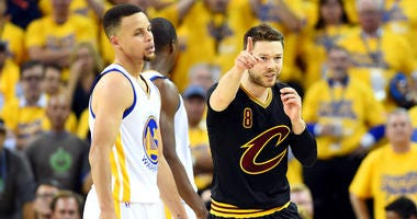 Jun 13, 2016; Oakland, CA, USA; Cleveland Cavaliers guard Matthew Dellavedova (8) reacts to a play against Golden State Warriors guard Stephen Curry (30) during the second quarter in game five of the NBA Finals at Oracle Arena. Mandatory Credit: Bob Donna