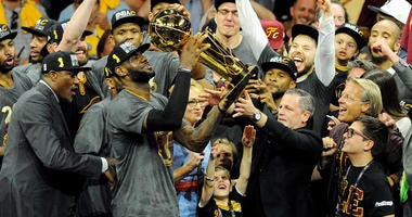 Cleveland Cavaliers forward LeBron James (23) celebratew with the Larry O'Brien Championship Trophy after beating the Golden State Warriors in game seven of the NBA Finals at Oracle Arena.
