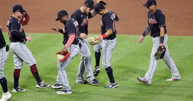 The Cleveland Indians celebrate after defeating the Pittsburgh Pirates at PNC Park. The Indians won 5-3.