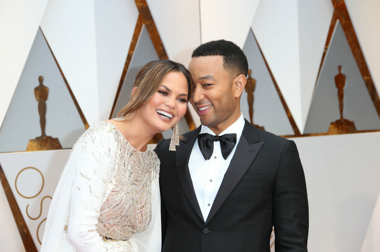 Chrissy Teigen and John Legend on the red carpet during the 89th Academy Awards at Dolby Theatre.