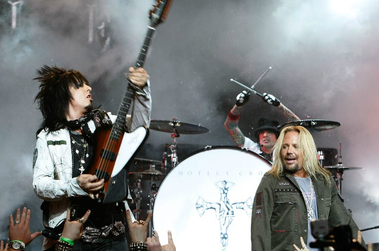 Nikki Sixx, Tommy Lee and singer Vince Neil of Motley Crue perform during a press conference annoucing Crue Fest 2008