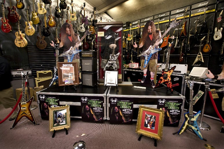 A memorial is displayed in honor of Pantera guitarist, the late Darrell 'Dimebag' Abbott, during his induction to the Hollywood Rock Walk at Guitar Center