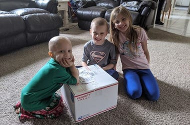 A Casey Cares Family With Their Care Package