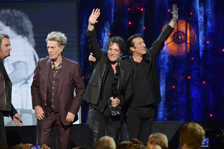 Ross Valory, Neal Schon, and Steve Perry of Journey onstage at the 32nd Annual Rock & Roll Hall Of Fame Induction Ceremony