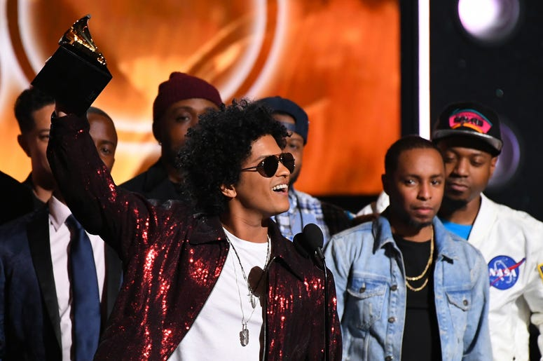 Bruno Mars accepts Album Of The Year for 24K Magic during the 60th Annual Grammy Awards at Madison Square Garden.