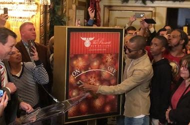 Trombone Shorty switches on the Christmas lights at the Roosevelt