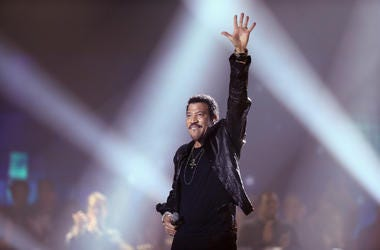 Lionel Richie performs on stage in 2012