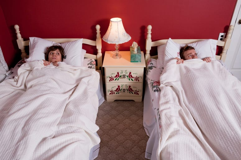 couples sleep in same bed