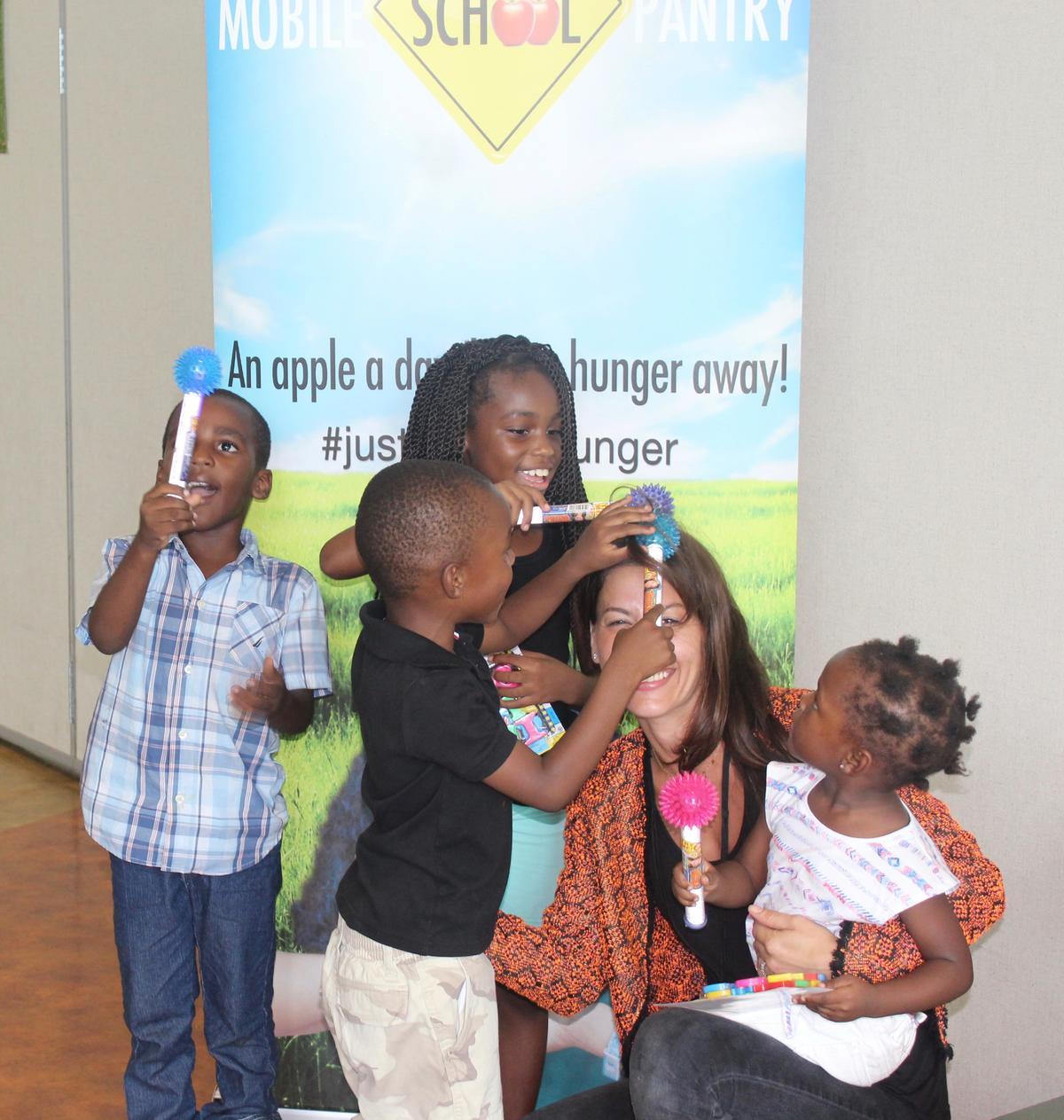 Z posing with kids