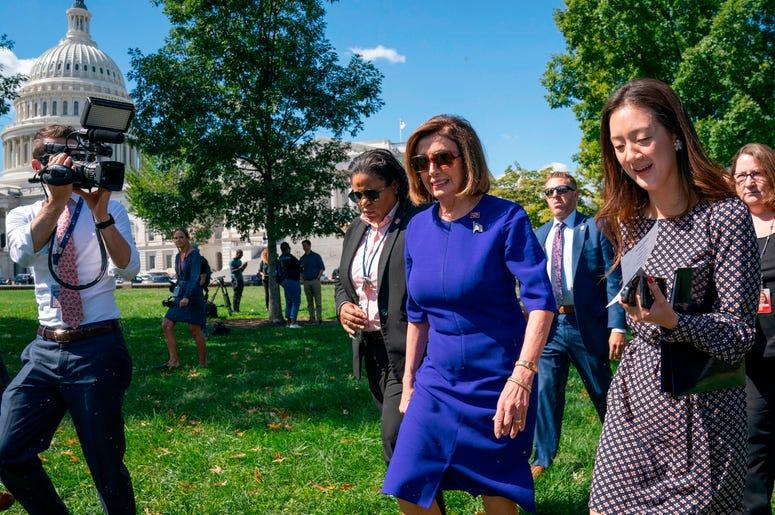 La presidenta de la Cámara de Representantes, Nancy Pelosi, se suma a un acto sindical en el Capitolio, Washington, martes 24 de septiembre de 2019.