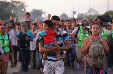 Members of a migrant caravan walk into the interior of Mexico after crossing the Guatemalan border on October 21, 2018 near Ciudad Hidalgo, Mexico The caravan of Central Americans plans to eventually reach the United States.