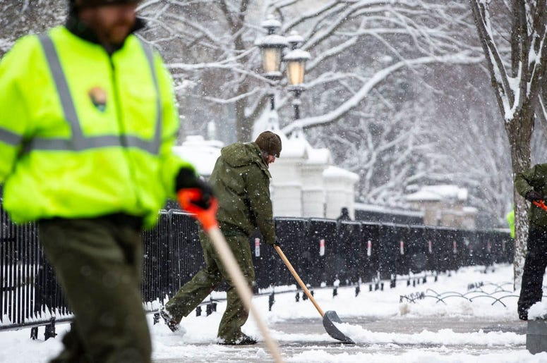WASHINGTON, DC - JANUARY 13: National Park Service workers shovel snow outside of the White House, on January 13, 2019 in Washington, DC. The DC area was hit with 4-7 inches of snow accumulation with the potential of another 2-4 inches.