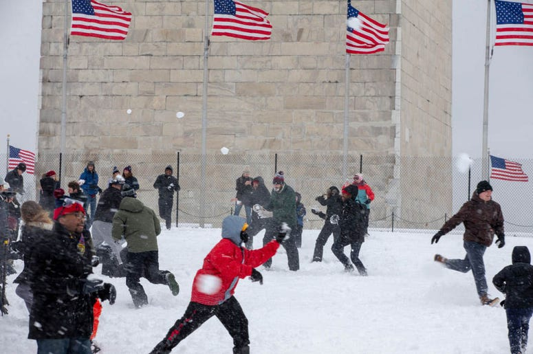 WASHINGTON, DC - JANUARY 13: People take part in the 'Snowdown Snowballs' at the Washington Monument on January 13, 2019 in Washington, DC. The DC area was hit with 4-7 inches of snow accumulation with the potential of another 2-4 inches.
