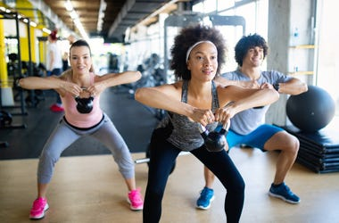 Group of healthy fit people training in gym