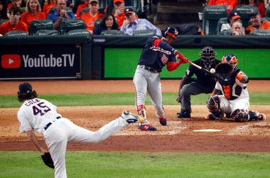 Juan Soto #22 of the Washington Nationals hits a solo home run on a pitch from Gerrit Cole #45 of the Houston Astros during the fourth inning in Game One of the 2019 World Series at Minute Maid Park on October 22, 2019 in Houston, Texas.