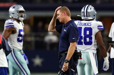 Head coach Jason Garrett of the Dallas Cowboys rubs his head during the game against the Buffalo Bills at AT&T Stadium
