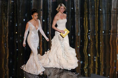 Presenters Jennifer Lopez (L) and Cameron Diaz speak onstage during the 84th Annual Academy Awards held at the Hollywood & Highland Center on February 26, 2012 in Hollywood, California.