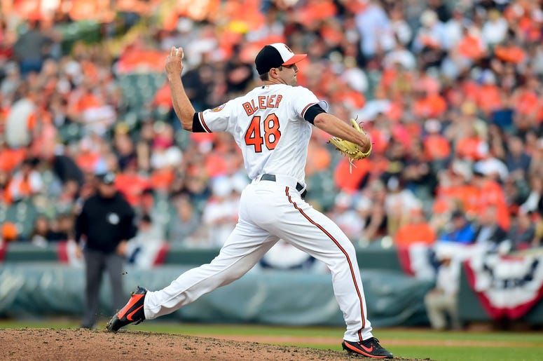 Baltimore Orioles pitcher Richard Bleier (48) throws a pitch in the eleventh inning against the Minnesota Twins at Oriole Park at Camden Yards.