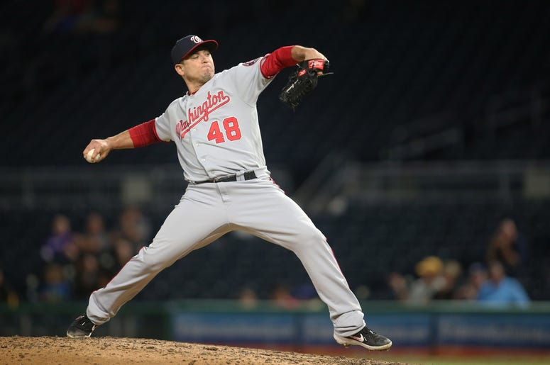 Aug 22, 2019; Pittsburgh, PA, USA; Washington Nationals relief pitcher Javy Guerra (48) pitches against the Pittsburgh Pirates during the ninth inning at PNC Park. The Nationals won 7-1. Mandatory Credit: Charles LeClaire-USA TODAY Sports