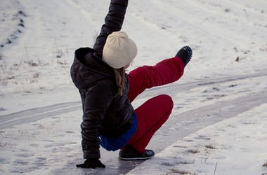 Woman falls on ice outdoors