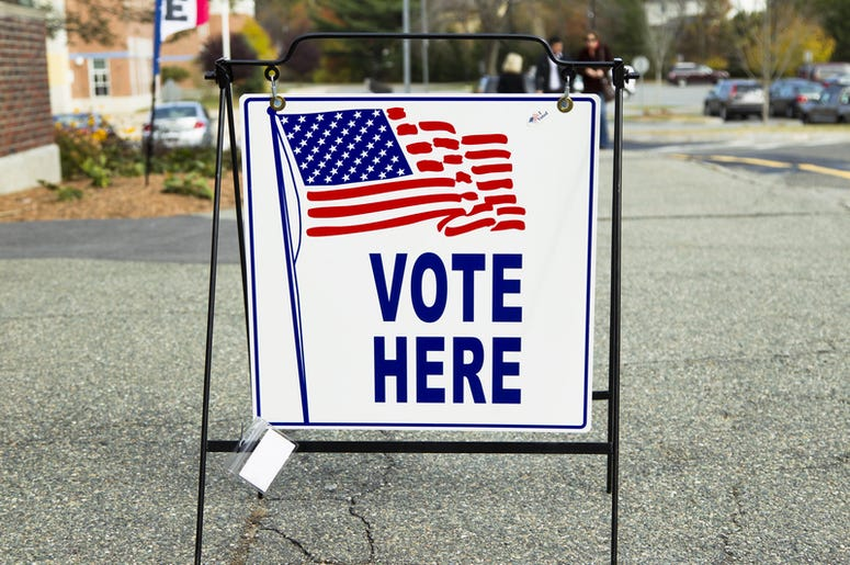 vote here sign at an election polling place