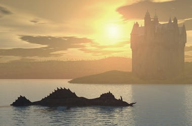 Loch Ness monster with a castle in the background