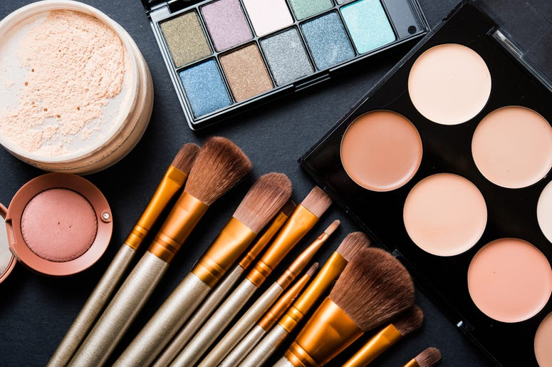 makeup and makeup brushes on a table