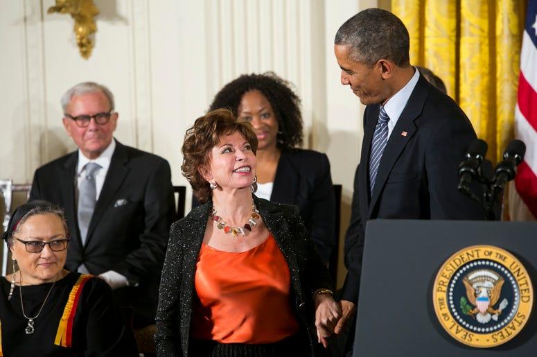 Isabel Allende smiles at Barack Obama as she receives the Presidential medal of Freedom