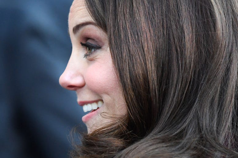 Kate Middleton smiles in profile