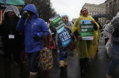 Immigration activists participate in a march February 12, 2019 in Washington, DC. Activists called on Congress to put permanent protections on Temporary Protected Status (TPS) holders